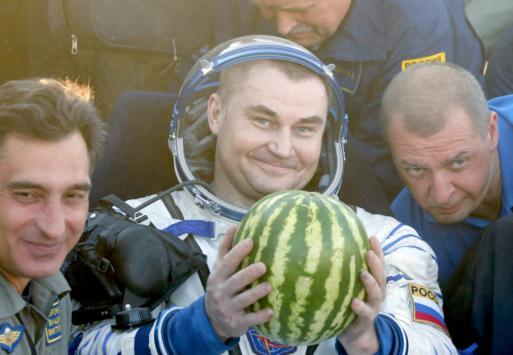 Russian cosmonauts Alexei Ovchinin, a member of the International Space Station crew, holds a water melon after landing some 150 km. to the East of the city of Dzhezkazgan in Kazakhstan, 07 September 2016.